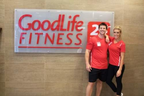 Goodlife fitness logo with two personal trainers